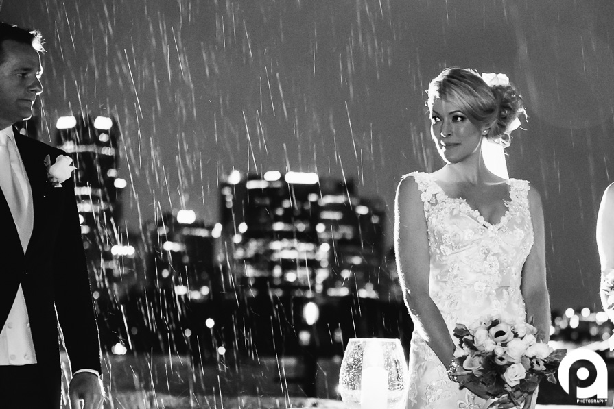Romantic wedding photo in rain