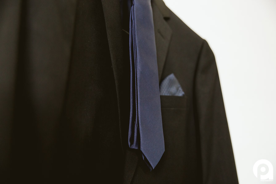 Geoff's stylish suit with dark blue tie