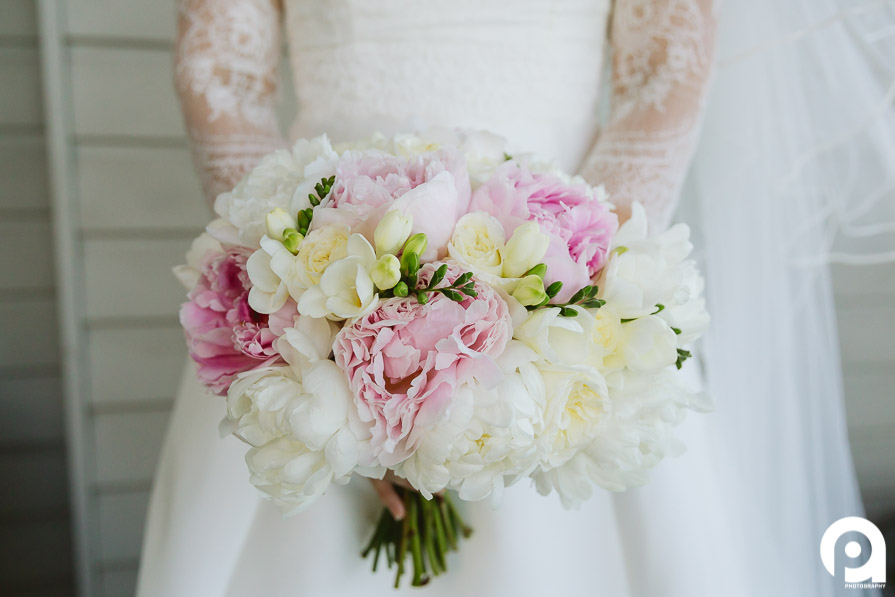 Love the flowers provided by Lavande Designs, which match the lace on the wedding gown perfectly