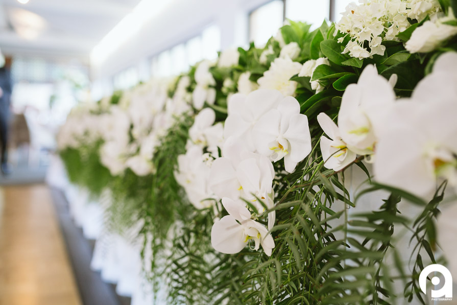 The bridal table was lined with smile white flowers