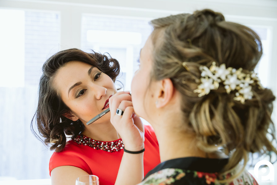 Sarah getting some final touch-up's before she gets her dress.