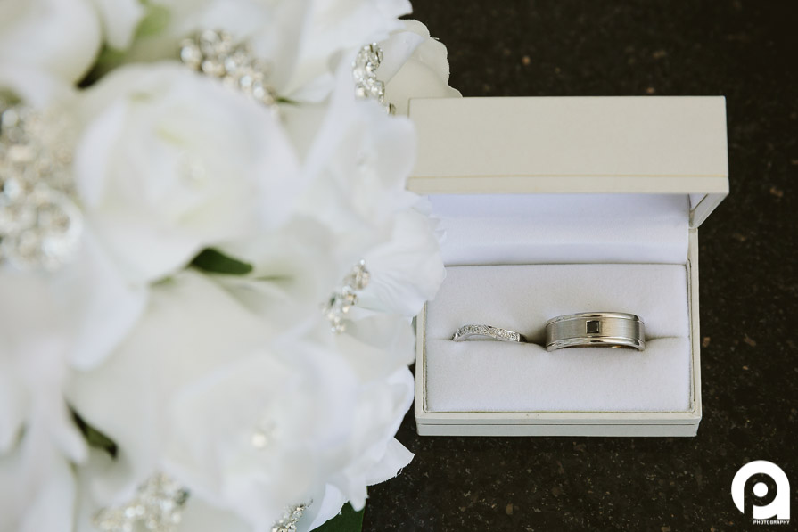 Detail photograph of the wedding bands & flowers