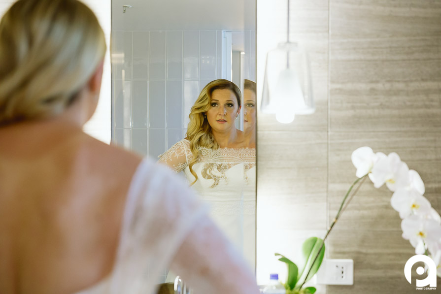 Bride reflection after putting on her wedding dress