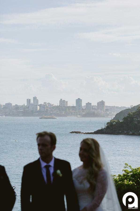 Sydney skyline with bride and groom