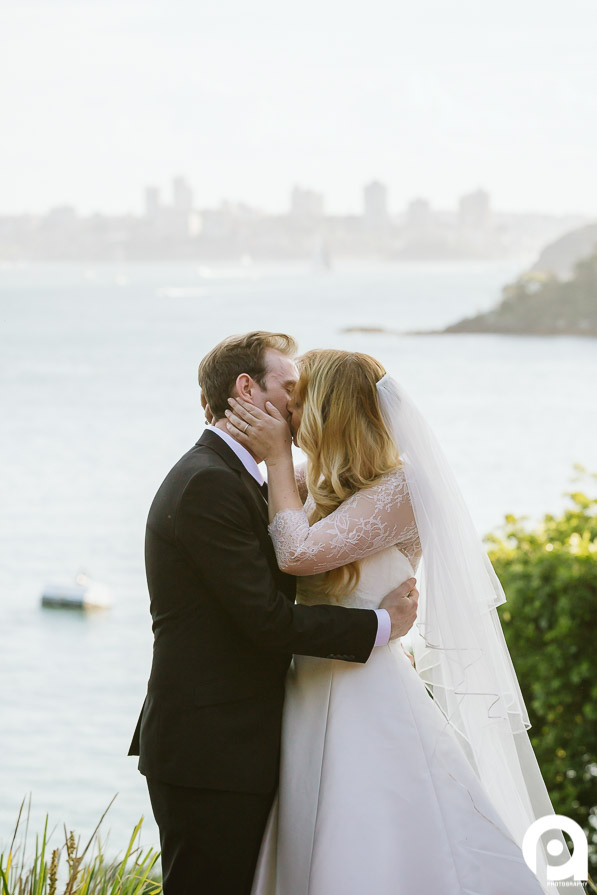 Not a bad spot to share your first kiss as husband and wife!