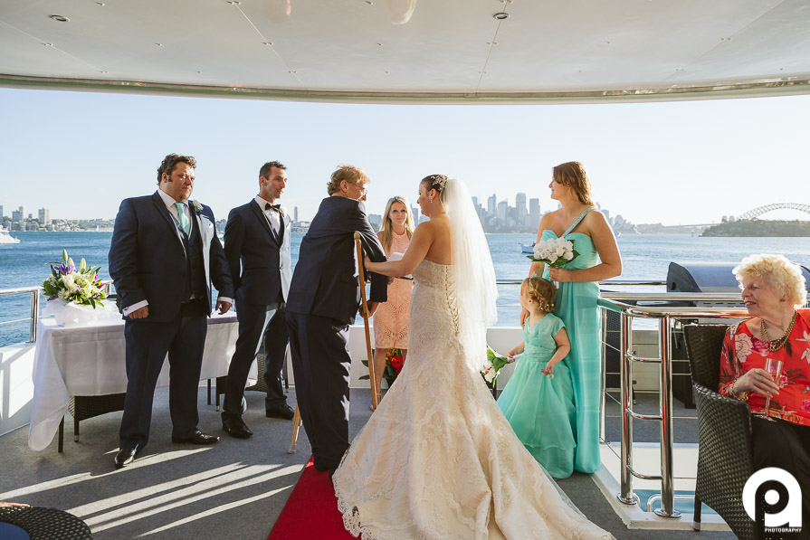 Although Sarah's dad was on crutches, he still managed to walk his daughter down the aisle (on a rocking boat!)