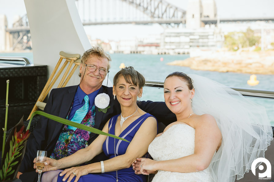 Sarah & her proud parents in front of the Sydney Harbour Bridge